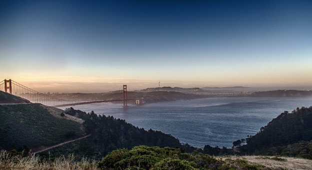 looking out towards the golden gate bridge with San francisco in the backdop at sunrise